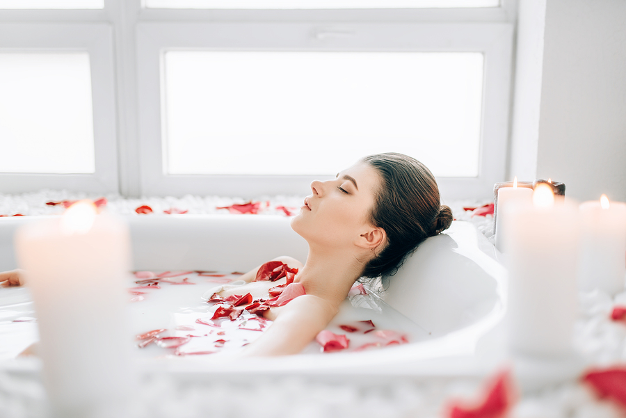 Woman Sleeps In The Bath With Cbd Bomb And, Rose Petals